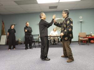 Grand Master Lee demonstrating techniques during test